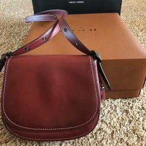 Maroon crossbody coach purse